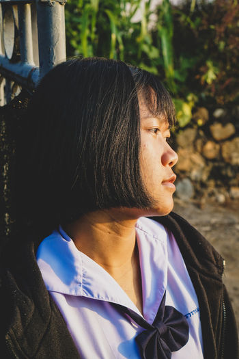 Close-up of thoughtful woman looking away