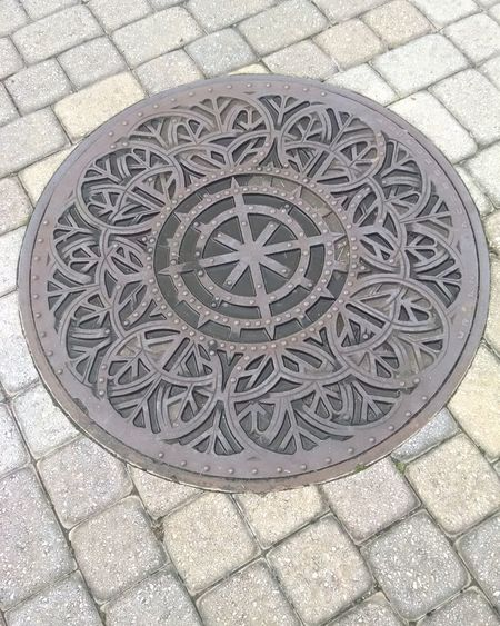 Manhole  Circle Street Pattern Metal Grate Outdoors Footpath Day Focus On Foreground Cityscapes Taking Photos Busy Day Working Hard Getting Things Done