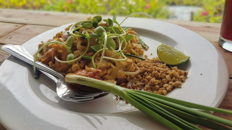 Close-up of pad thai in plate on restaurant table