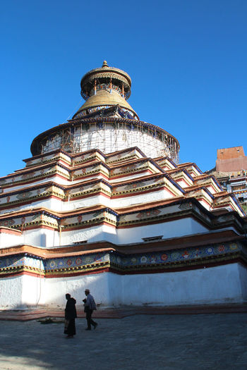 The famous Kumbum Stupa at the Palcho Monastery in Gyantse, Tibet, China Adult Ancient Architecture Building Exterior Cloud - Sky Cultures Day History Men Outdoors Palcho Monastery People Place Of Worship Religion Sky Spirituality Stupa Tourism Travel Destinations 白居寺