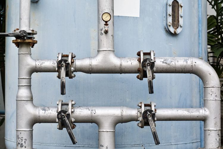 Close-up of machine valve at factory