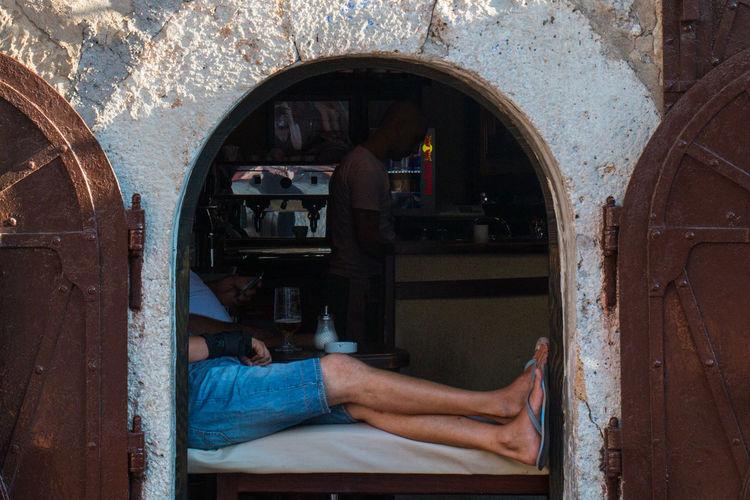 Man sitting on old door