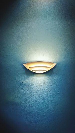 Lamp on a blue