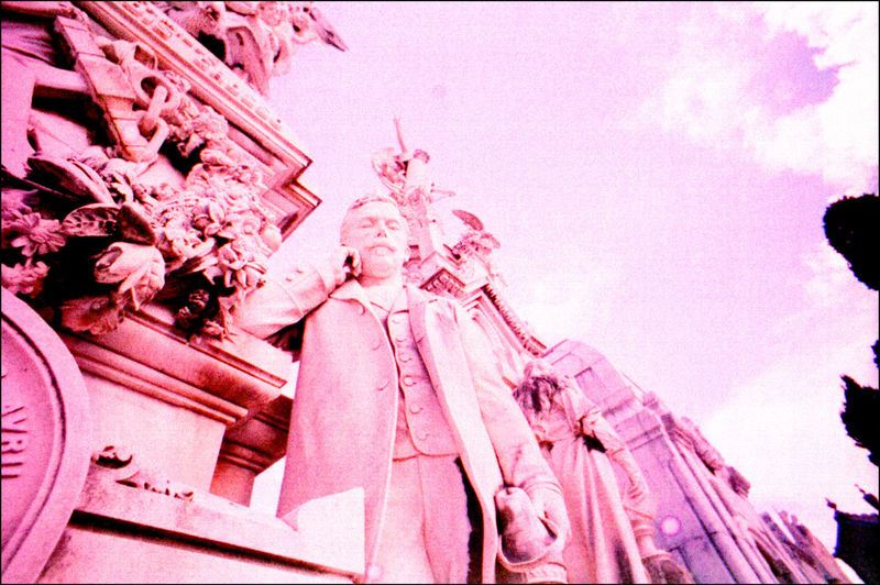Low angle view of pink and statue against sky