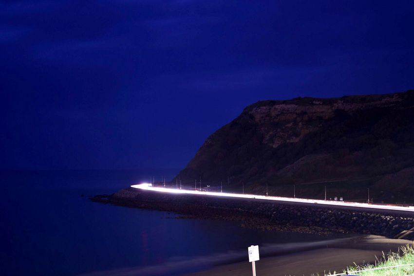 Night Nature Sea Beauty In Nature Scenics Illuminated Transportation Clear Sky No People Light Trail Water Tranquility Outdoors Blue Mountain Sky High Angle View Travel Destinations Scarborough Seaside Nature City