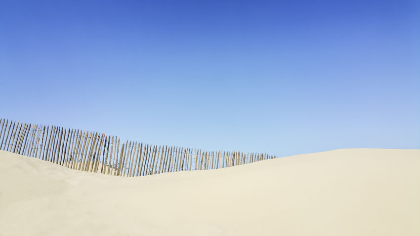 Beach Beauty In Nature Blue Blue Sky Clear Sky Dune Dunes Eye4photography  EyeEm Gallery EyeEm Nature Lover Fence Landscape Minimal Minimalism Minimalobsession Nature No People Sand Sand Dune Scenics Soft Sunny Tranquil Scene Tranquility The Secret Spaces The Week On EyeEm