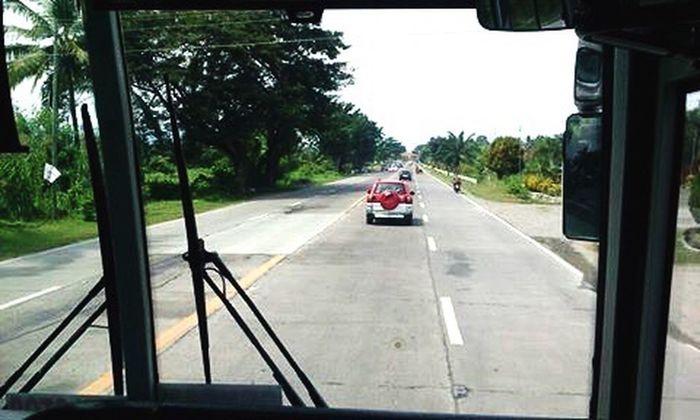 ...to Gen San. 🚌 EyeEmNewHere EyeEm Best Shots Transportation Driving Car Outdoors Road No People Day Tree Traveling Philippines Travel Filipinosbelike