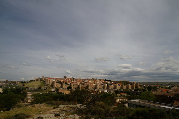Townscape against cloudy sky