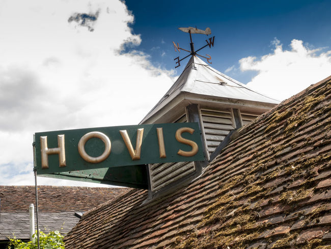 Man Cave Signs in back garden Shoreham Kent Advertising Back Shed Black Out Board Building Exterior Built Structure Cloud - Sky Day House Hovis Kent Looting Low Angle View Lyons Tea Man Cave News Of The World No People Old Tin Signs Outdoors Plane Wreckage Robinsons Signs Sky Text Village Vivid International