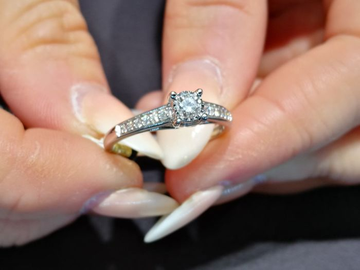 Close-up of woman hands holding diamond ring
