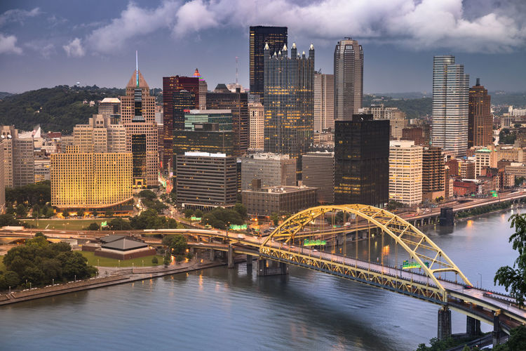 Pittsburgh city landscape view over the Monongahela and Allegheny River Allegheny River Architecture Connection Fort Duquesne Bridge Monongahela River Pittsburgh Rachel Carson Bridge Roberto Clemente Bridge USA United States Andy Warhol Bridge Boat Bridge Buildings City City Life Cityscape Day Downtown Fort Pitt Fort Pitt Bridge Office Building Pennsylvania River Riverfront Shipping  Skyline Skyscrapers Structure Tourism Transportation Water Waterfront Built Structure Building Exterior Office Building Exterior Skyscraper Bridge - Man Made Structure