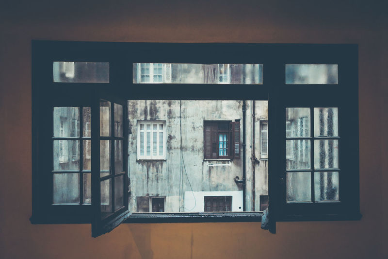 old window looking out on an old building on a rainy day. Architecture Atmospheric Mood Building Exterior Built Structure Decay Decaying Building EyeEm Gallery Façade Indoors  Looking Out Of The Window No People Old Building  Open Window Palacio Salvo Rainy Day Urban Urban Exploration Urbanphotography Window The City Light The Architect - 2017 EyeEm Awards