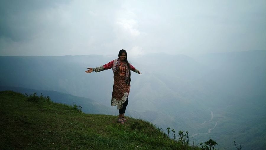Breathing Space One Woman Only Only Women One Person Arms Outstretched Adult Adults Only Landscape Mountain Full Length People Nature Outdoors Women Human Body Part Rural Scene Day Fog Beauty In Nature Young Adult Scenics Shades Of Winter