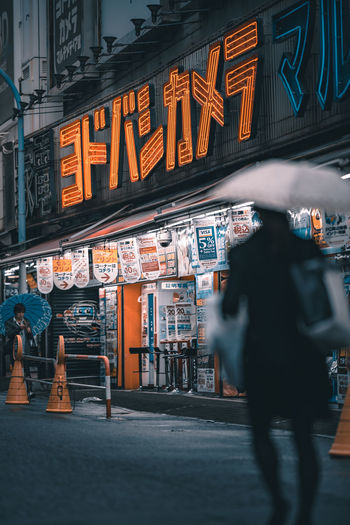 A series of 3 - Tokyo is transformed when it rains. this series highlights what you will see once the rain comes out. Japan Rain Rainy Days The Street Photographer - 2018 EyeEm Awards Tokyo Tokyo,Japan WeekOnEyeEm Architecture Building Exterior Built Structure City City Life Illuminated Men Neon Outdoors People Real People Street Streetphotography Text Umbrella Week On Eyeem