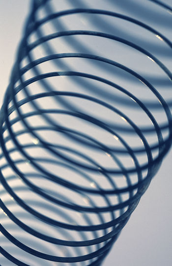 metal spring retro toy Abstract Circle Circle Coil Coiled Metal Pattern Repetition Retro Shape Shapes Slinkey Slinky  Spiral Spring Springly! Steel Toy Wire