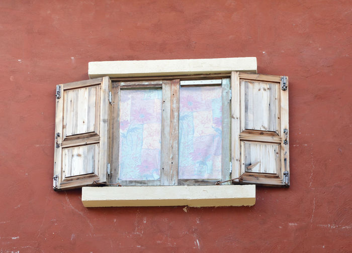 Low angle view of old window