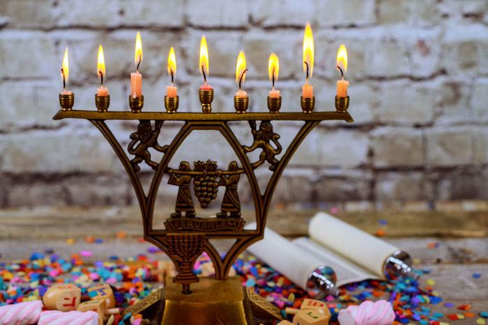 Bronze Hanukkah menorah with burning candles on wooden table front old vintage concrete wall Holiday concept. Hanukkiah Jewish Holiday Menorah Candle Hanukkah Menorah Jewish Judaic Shalom Celebration, Hanuka Judaica Judaism Religion Religious