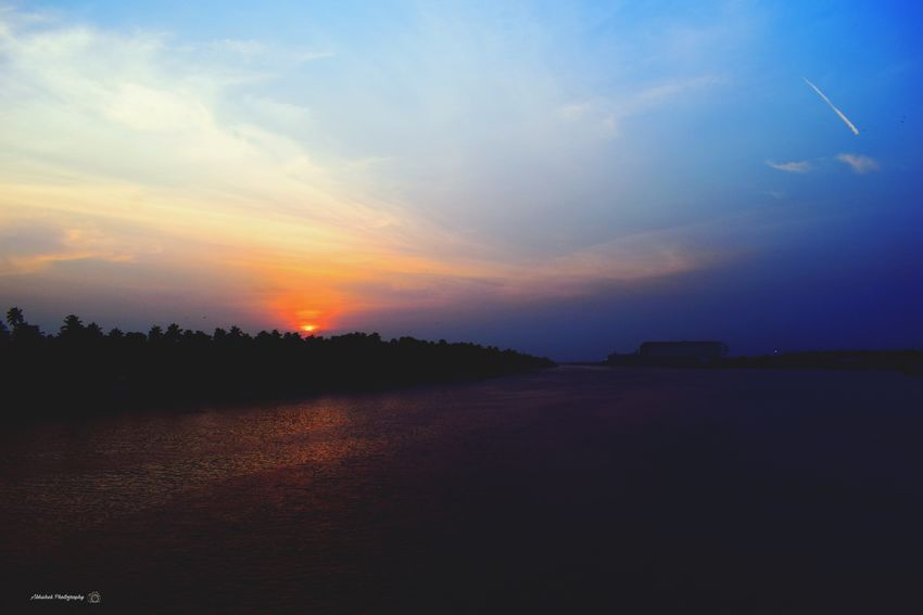 EyeEm Edits Clicked On Nikon D3300 Water Water Reflections Sunset Sunset Silhouettes Sky Multi Colored Trees Reflection Evening Dramatic Sky