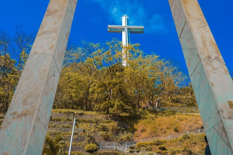 Gob bless us Mtsamat Mountain Low Angle View Tree Religion Spirituality Cross Day No People Place Of Worship Built Structure Architecture Nature Sky Outdoors