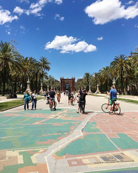 Gate Map SPAIN Catalonia Barcelona Tourism Destination Tourists Cycling Palm Tree Tree Sky Sunlight Bicycle Day Outdoors Cloud - Sky Real People