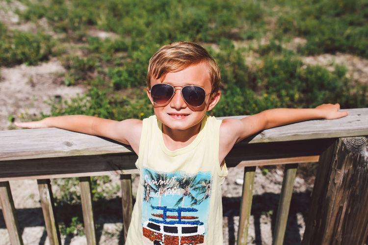 Portrait of boy wearing sunglasses outdoors