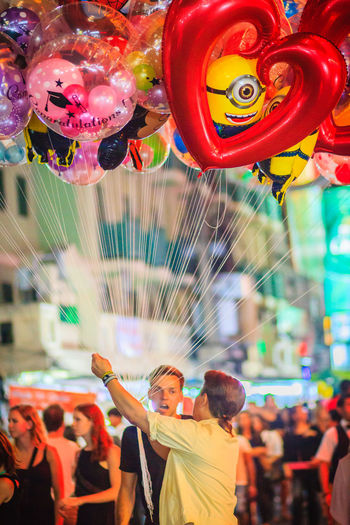 Bangkok, Thailand - March 2, 2017: Street vendor is selling cute balloons at Khao San Road night market, Bangkok, Thailand. Khao San Rd Khao San Road KhaoSan Khaosan Rd. Khaosandroad Tourist Tourist Attraction  Tourists Adult Amusement Park Amusement Park Ride Arts Culture And Entertainment Balloons Blurred Motion Digital Composite Emotion Enjoyment Excitement Fun Group Of People Happiness Incidental People Khao San Khao San Knok Wua Khao San Rd. Khaosan Road Khaosanroad Leisure Activity Lifestyles Men Motion Multi Colored Night Market Night Market In Thailand Night Market, Outdoors People Real People Tourist Destination Women