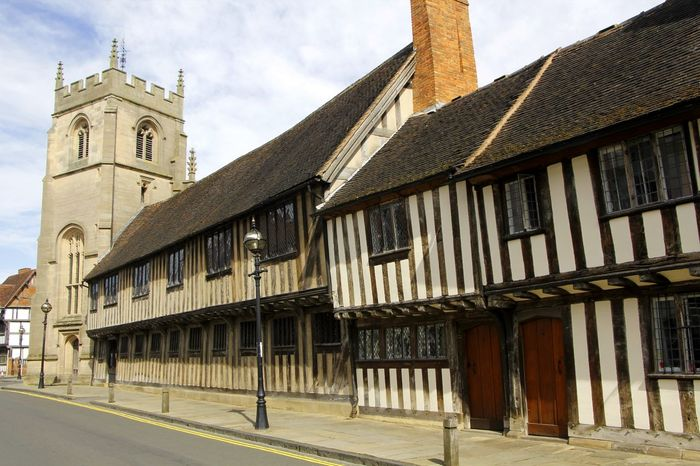 The structure of medieval buildings in Stratford upon Avon England. Antiquated Church Tower Historical Building Tourist Attraction  Architecture Building Exterior Built Structure City Day History Landmark Medieval Medieval Architecture No People Old Buildings Outdoors Sky Street Tourist Destination Urban