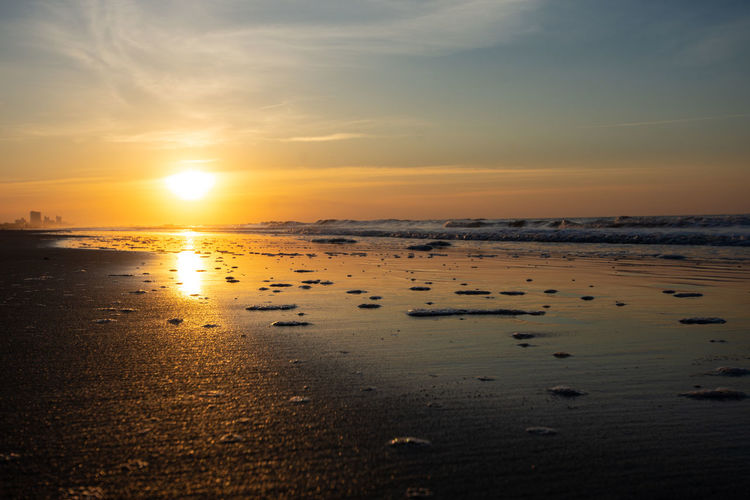 Southern Sunrise Sunset Water Sky Sea Beach Beauty In Nature Scenics - Nature Land Tranquility Tranquil Scene Reflection Orange Color Sun Cloud - Sky Nature Sunlight No People Idyllic Sand Horizon Over Water Outdoors Sunrise Morning Reflection
