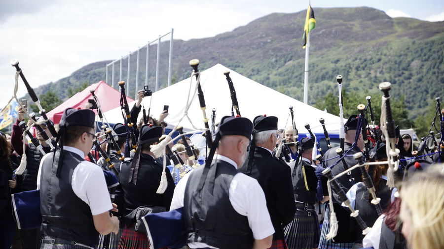 Bagpipes Clothing Crowd Day Event Government Group Of People Large Group Of People Lifestyles Men Military Mountain Nature Outdoors Real People Security Sky Street Transportation Uniform