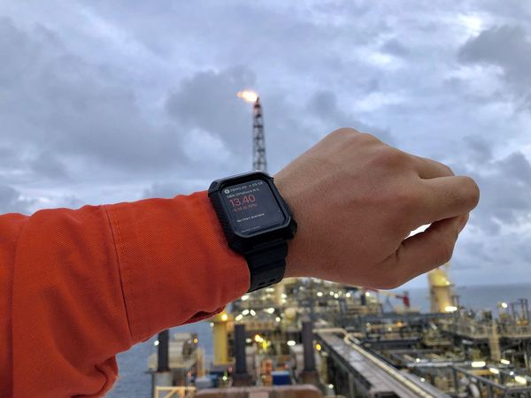 Checking SBM Offshore share price on Apple Watch Sbmo.as Morning Light Protective Clothes Apple Watch Flare Stack Offshore Platform Oil And Gas FPSO Shares Trade Market Market Share Share Price SBM Offshore Sbm Human Hand Hand Cloud - Sky Architecture Building Exterior Built Structure Human Body Part One Person Watch Wristwatch Focus On Foreground Outdoors Sky