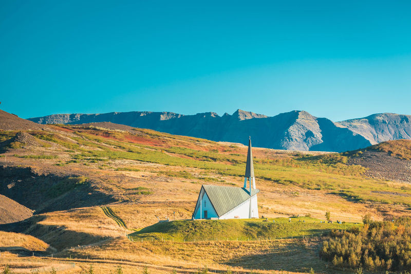 Beauty In Nature Church Clear Sky Day Iceland Landscape Mountain Mountain Range Nature No People Outdoors Scenics Sky Travel Destinations