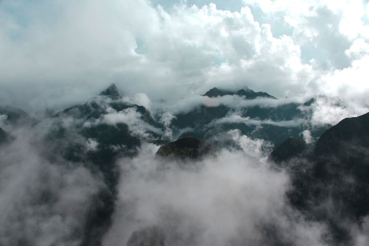 Scenic view of majestic mountains against sky