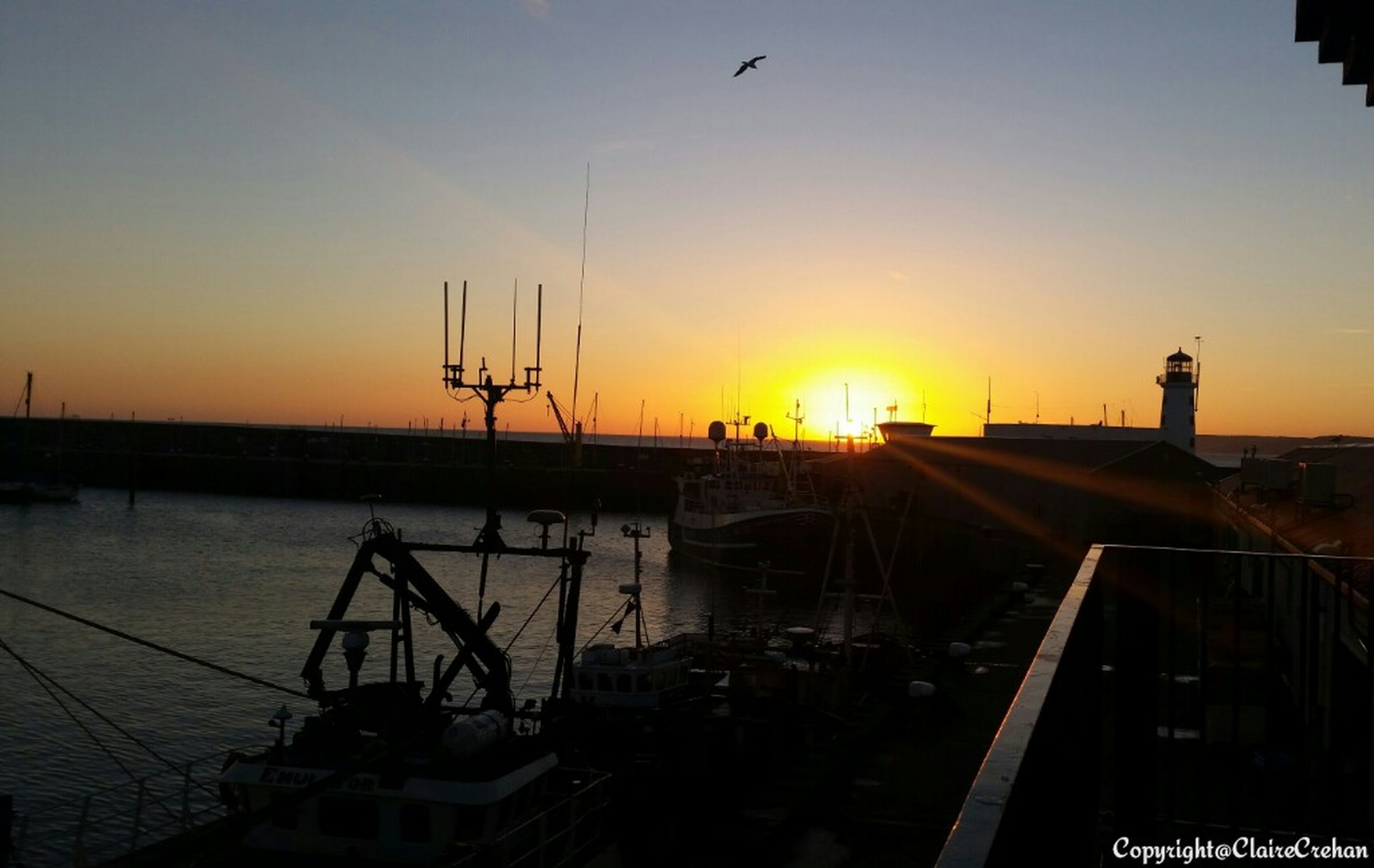 sunset, sun, orange color, silhouette, sky, transportation, water, sea, sunlight, nature, built structure, scenics, beauty in nature, mode of transport, harbor, tranquility, outdoors, idyllic, architecture, no people