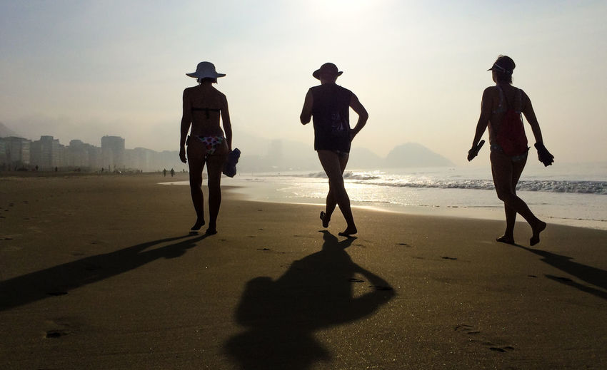 Beach Coastline Copacabana Escapism Friendship Fun Horizon Over Water Leisure Activity Lifestyles Light Ocean Relaxation Rio De Janeiro Sand Sea Shore Silhouette Summer Sunrise Sunset Togetherness Vacations Water Wave