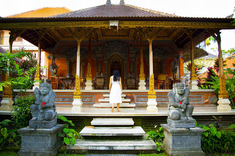 Statue outside temple against building