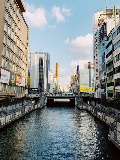 Osaka Osaka,Japan Travel Destinations Japan OSAKA Building Exterior Built Structure Architecture Water City Sky Building Cloud - Sky Nature No People Day Residential District Waterfront