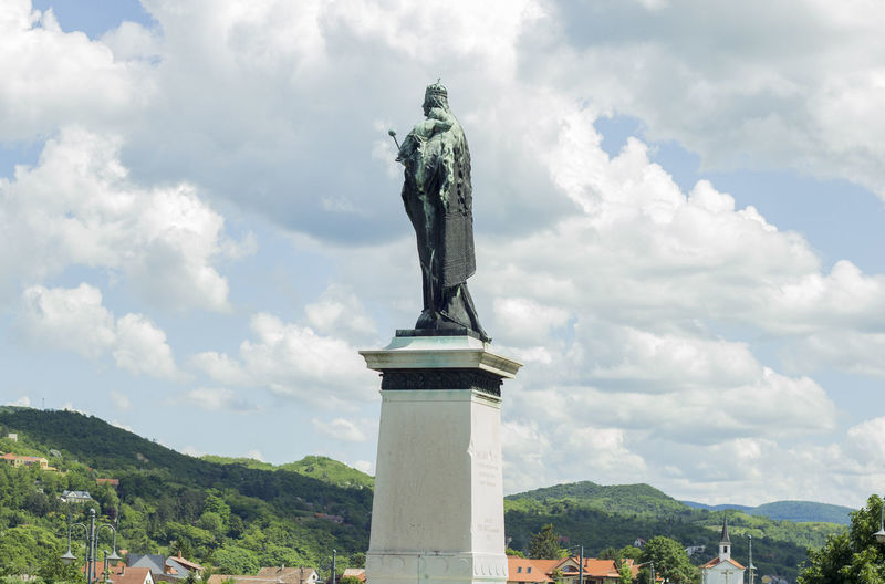 Low Angle View Of King Statue Against Cloudy Sky