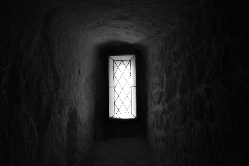 Dark window Black & White Abandoned Blackandwhite Dark Light At The End Of The Tunnel No People Old Prison Wall Wall - Building Feature Window