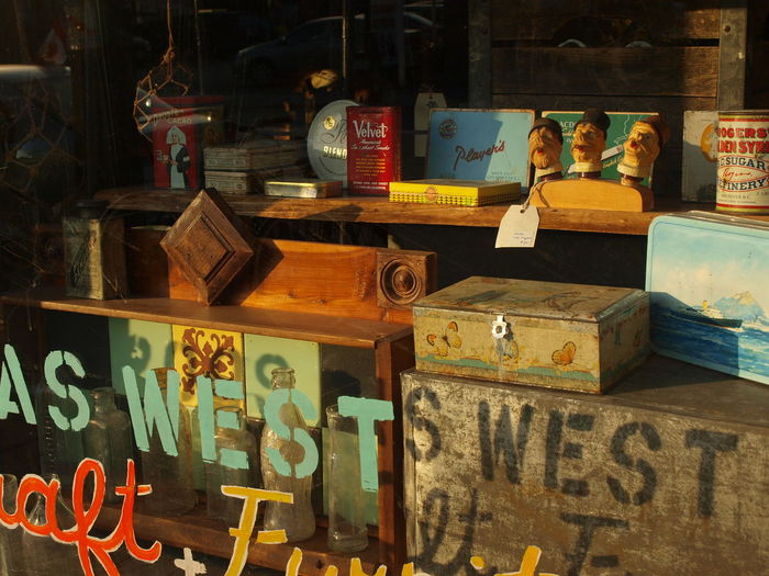 Antique Ima Collectables In Window Font Shadows Large Group Of Objects No People Storefront Text On Window Vintage Store F Warm Morning