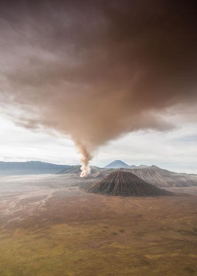 The eruption of mount bromo darken the sky of the surrounding city.