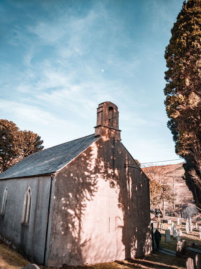 a Welsh chapel with the crescent moon above Moon Crescent Crescent Moon Cirrus Clouds Peaceful Winter Wales UK Rural Scene Tree Shadows Trees Remote Chapel Church Cemetery Countryside Hills Golden Hour Sky Architecture Gravestone Grave The End Mourning Tomb Death Graveyard Place Of Burial