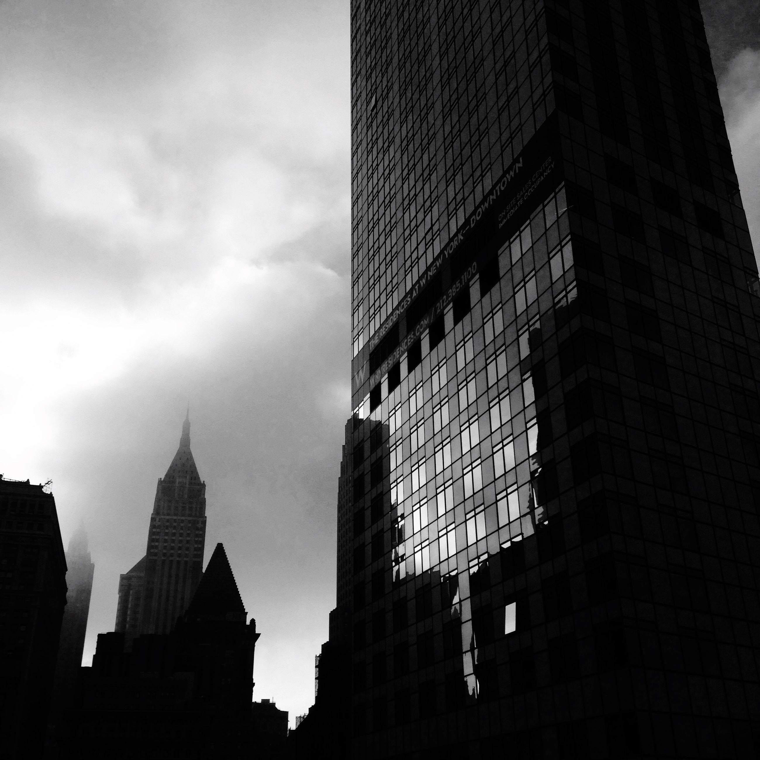 architecture, building exterior, built structure, city, low angle view, skyscraper, sky, tall - high, office building, tower, modern, building, cloud - sky, tall, city life, silhouette, outdoors, capital cities, cloud, no people