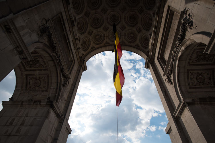 Low Angle View Of German Flag On Historic Building Against Sky