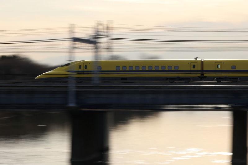 High speed train on bridge against sky