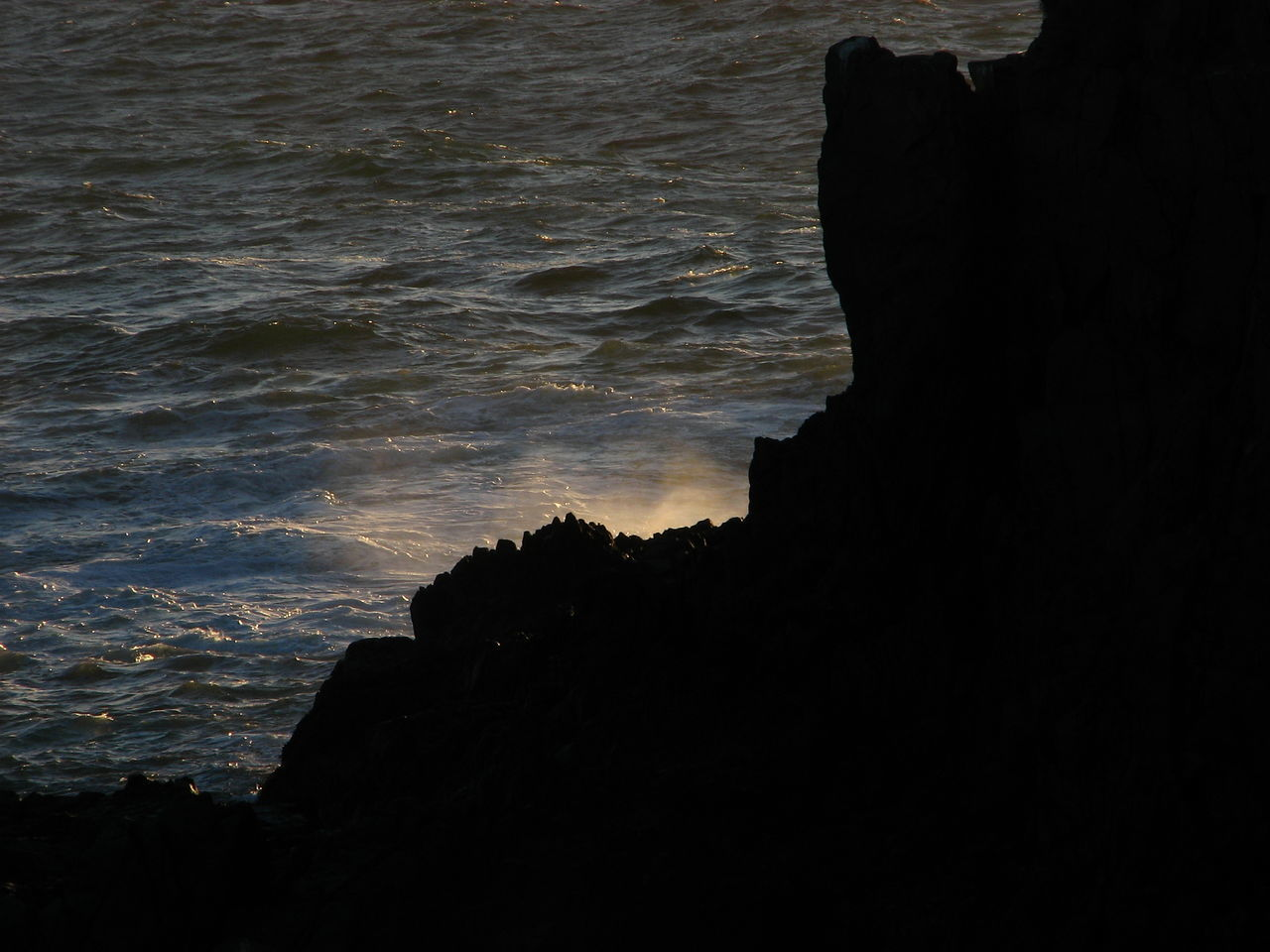 silhouette, rock formation, rock - object, nature, sea, sunset, beauty in nature, water, outdoors, no people, sky, scenics, travel destinations, wave, day