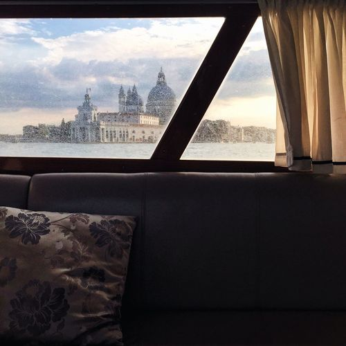 Punta Della Dogana And Canal Seen Through Window In Boat