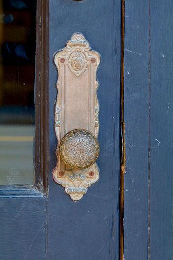 Close-up of sculpture on wooden door