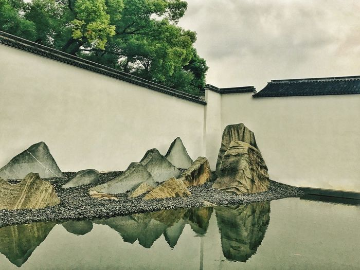 Suzhou Museum. Building Exterior Architecture Built Structure Water Reflection Day Outdoors No People Sky Window Tree Nature Roof Low Angle View Beauty In Nature Close-up