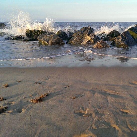 Nofilters Caister Caisteronsea Seaside sand rocks tide sky blue bluesky beach htcone htc1 springevening spring waves sea spray splash