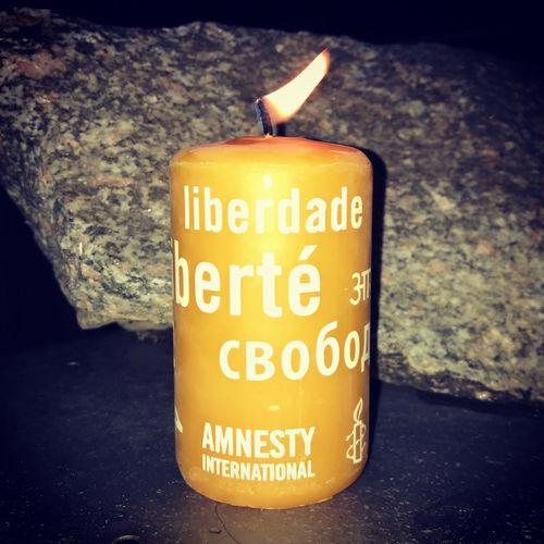 Amnesty International Candle Burning Flame